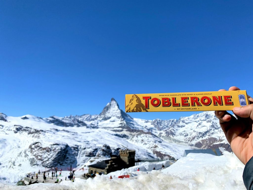 We bought a Toblerone from the souvenir shop for this picture! Things to do in 1 day in Zermatt